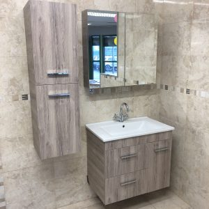 The stunning brown Aegean Bathroom Furniture Set. The set consists of a Wall Storage Cabinet, Mirror Cabinet and Wall Hung Basin Cabinet (selection of taps sold separate).